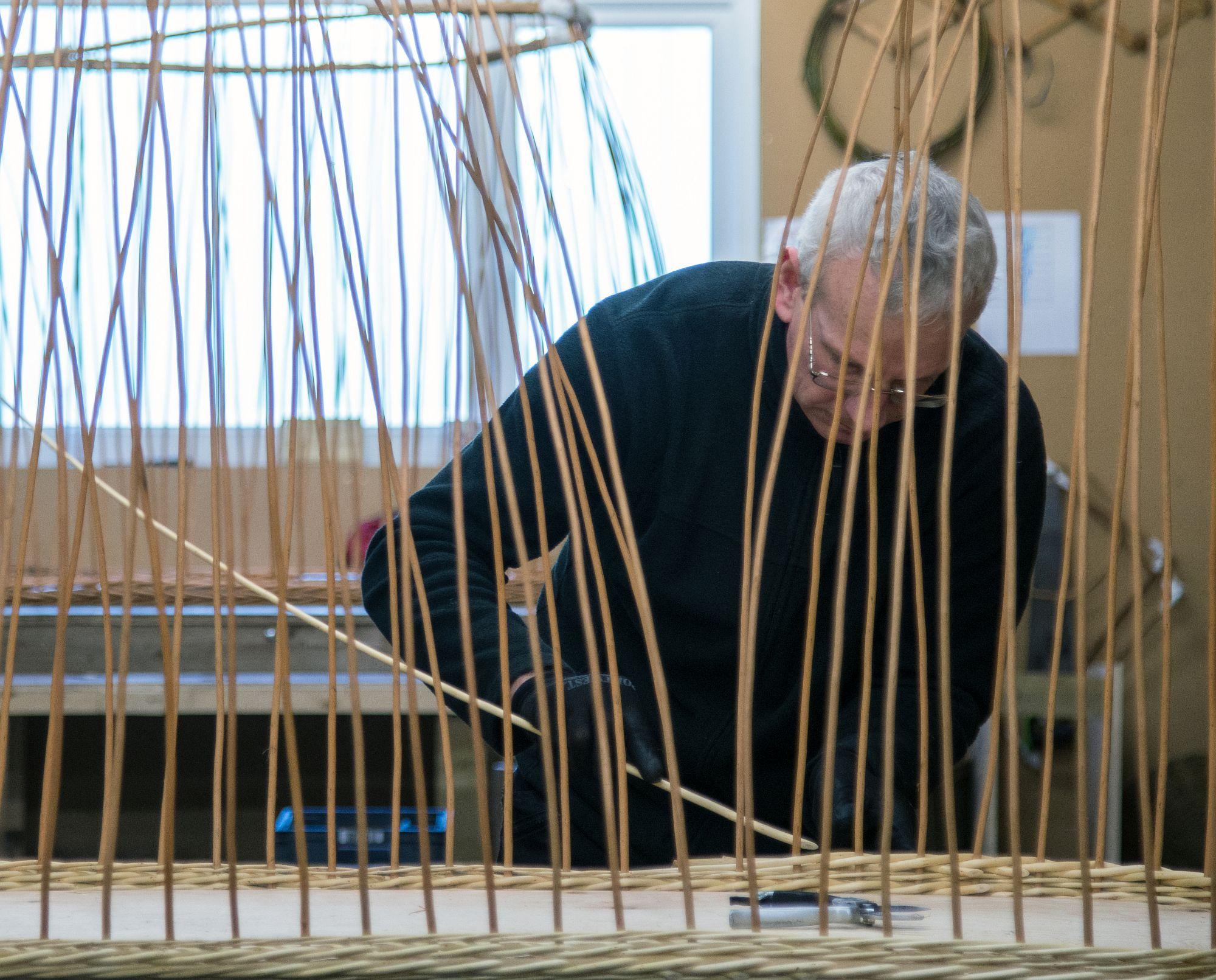Weaving a willow / wicker coffin